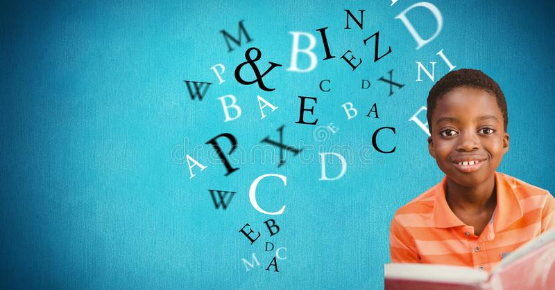 Male student smiling while letters flying in background. Digital composite of Male student smiling while letters flying in background stock photo
