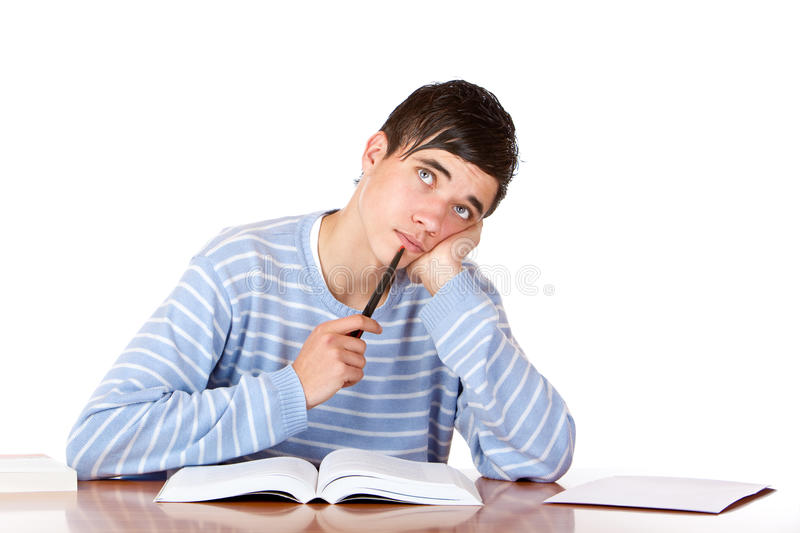 Male student with study books looks contemplative royalty free stock photo