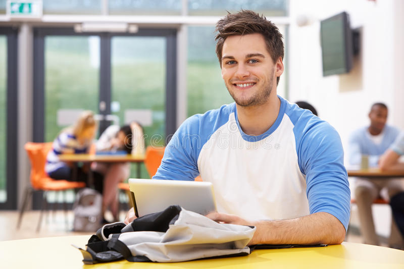 Male Student Studying In Classroom With Digital Tablet royalty free stock images
