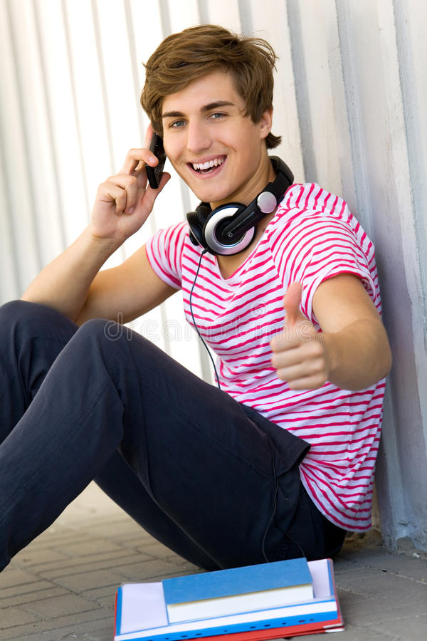 Male Student With Thumbs Up Stock Image