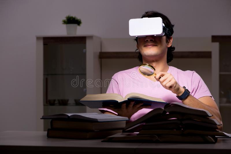 The male student with virtual glasses late at home. Male student with virtual glasses late at home royalty free stock photo