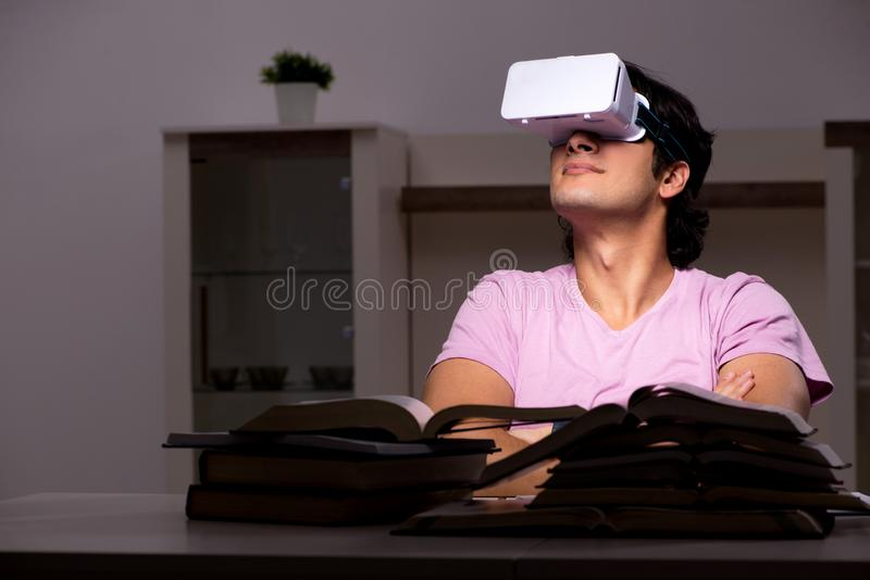 The male student with virtual glasses late at home. Male student with virtual glasses late at home royalty free stock photos