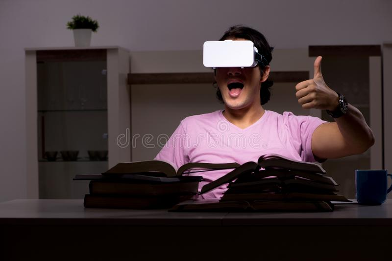 The male student with virtual glasses late at home. Male student with virtual glasses late at home stock images