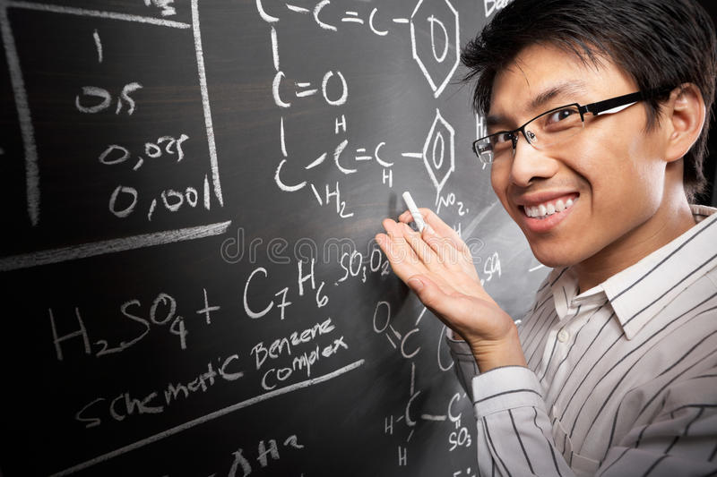 Male student working on equation royalty free stock photography