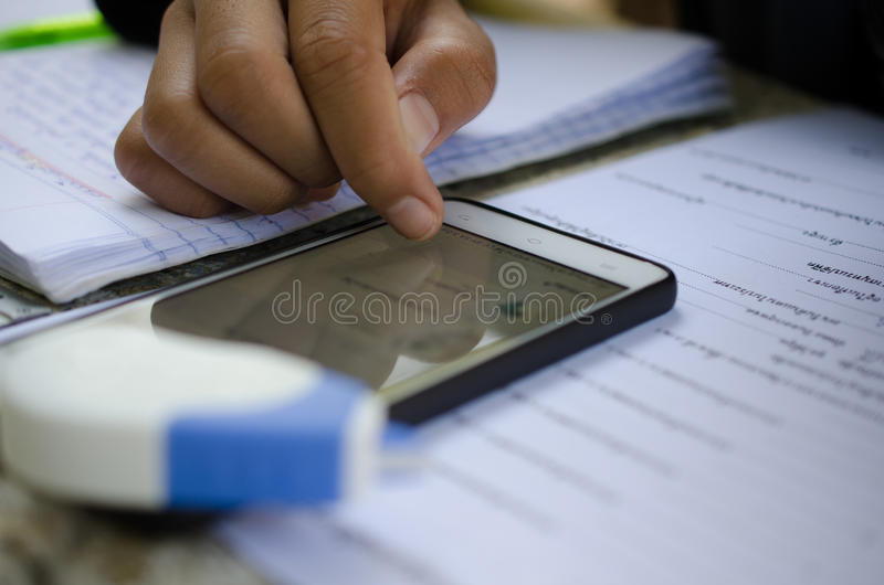 Male students are doing homework with intent. Search the Intern royalty free stock images
