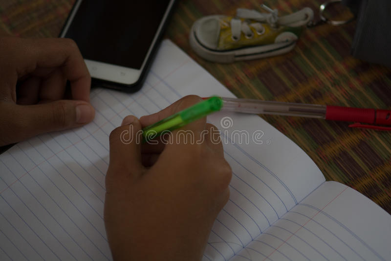 Male students are doing homework with intent. Search the Internet and in phone books. To prepare teachers. royalty free stock photo