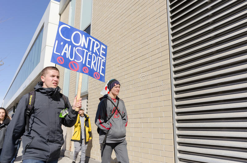 Male students holding pancard against gouvernement austerity royalty free stock images