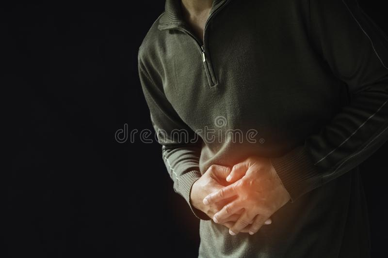 Male suffering from stomachache pain. A man stomachache. Healthy concept stock photography