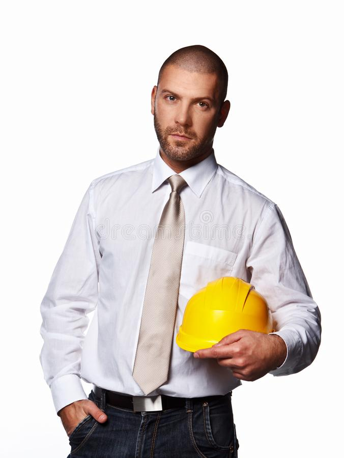 Male in a suit with hard hat royalty free stock photo