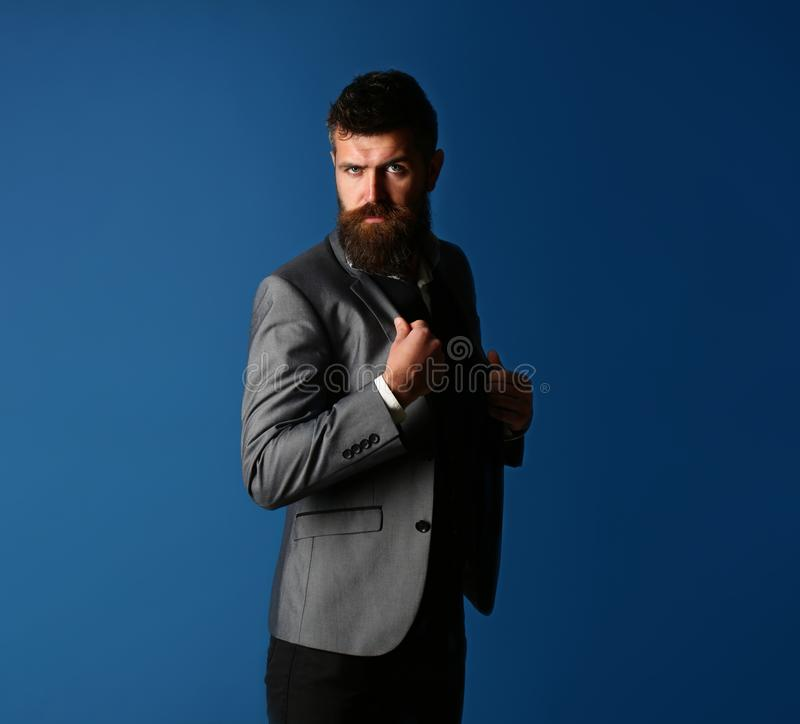 Male in suit, man in tuxedo, stylish man in a cloth jacket. Handsome bearded businessman in classic suit. Businessman in. Vest. Elegant guy, classic tuxedo and royalty free stock image