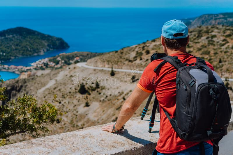 Male summer holiday vacation on Kefalonia Greece. Photographer with backpack enjoying capture of Mediterranean village royalty free stock photo