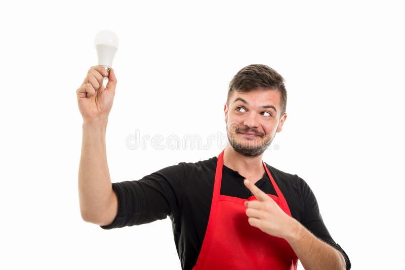 Male supermarket employer pointing light bulb like good idea. Gesture isolated on white background stock photos