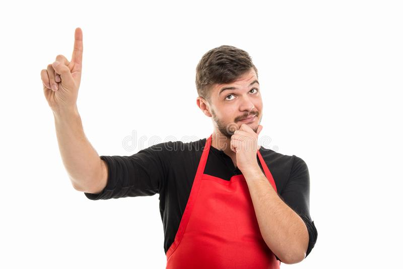 Male supermarket employer showing index finger like good idea. Gesture isolated on white background royalty free stock photos