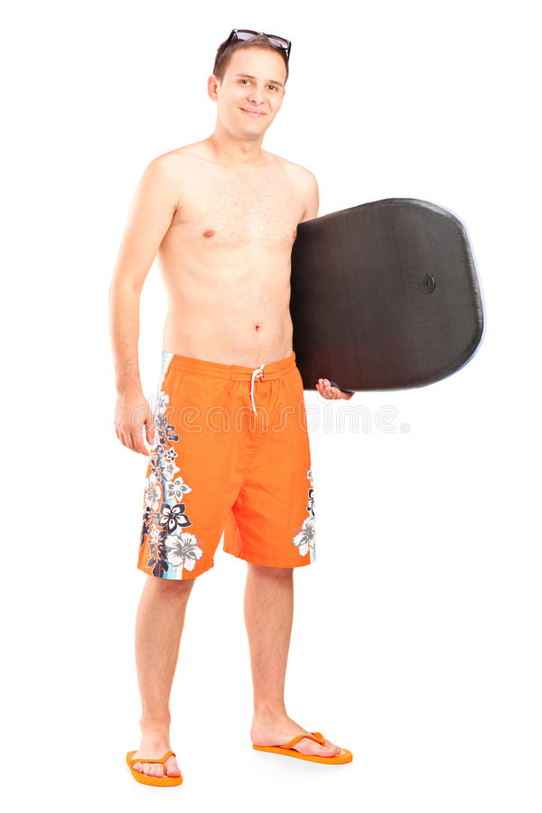 Male surfer posing with his surfboard. Full length portrait of a male surfer posing with his surfboard on white background royalty free stock photo