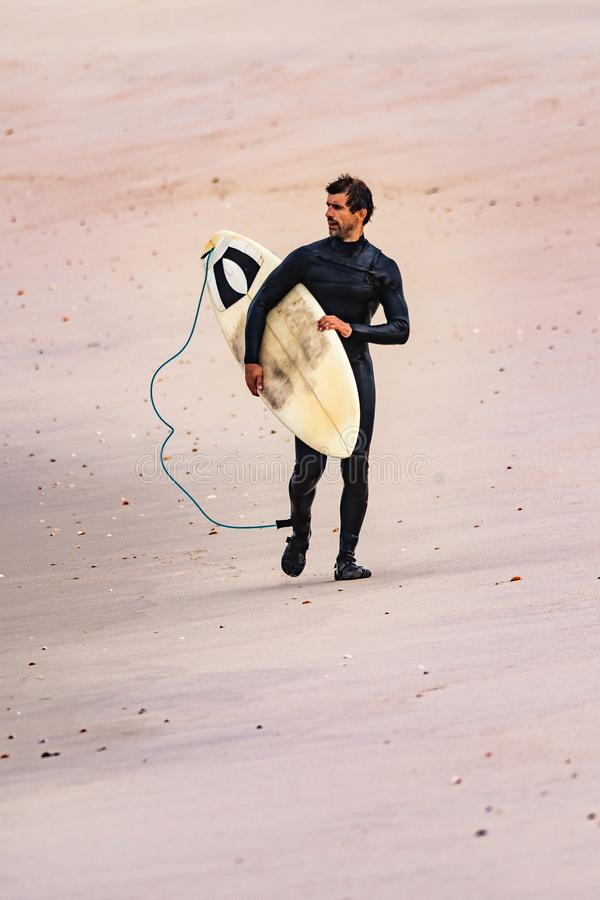Male surfer wearing wetsuit royalty free stock photography