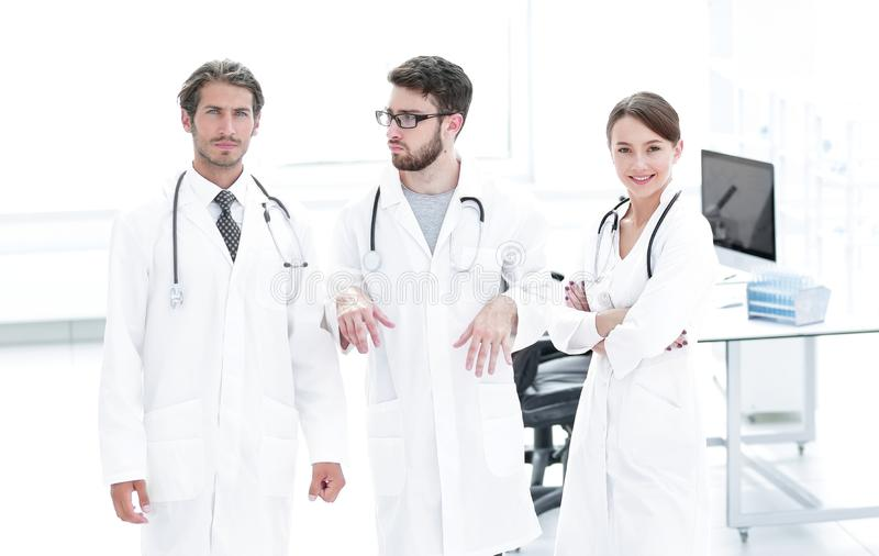 Male surgeon with nurse examining x-ray report. Shot of a female doctor, analyzing an X-ray examination of a patient with colleagues royalty free stock photo