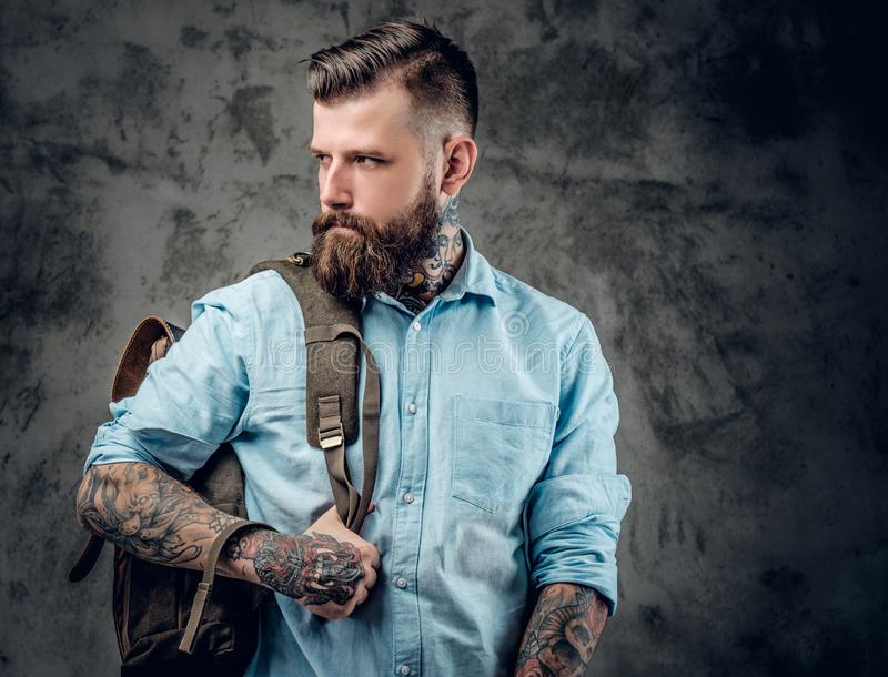 Male with tattooes on his arms and neck. stock photo