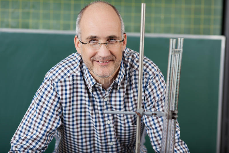 Male teacher giving physics lessons stock photos