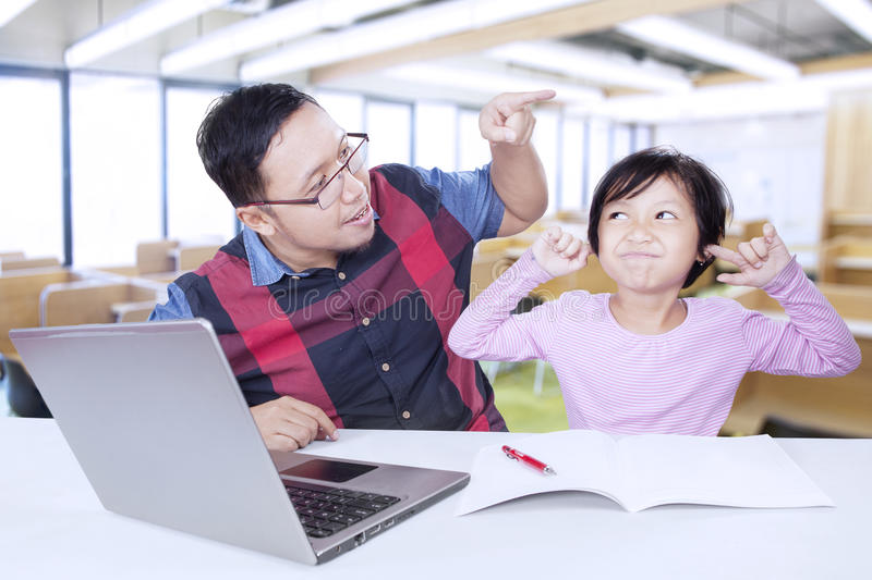 Male teacher scolding his lazy student royalty free stock photography