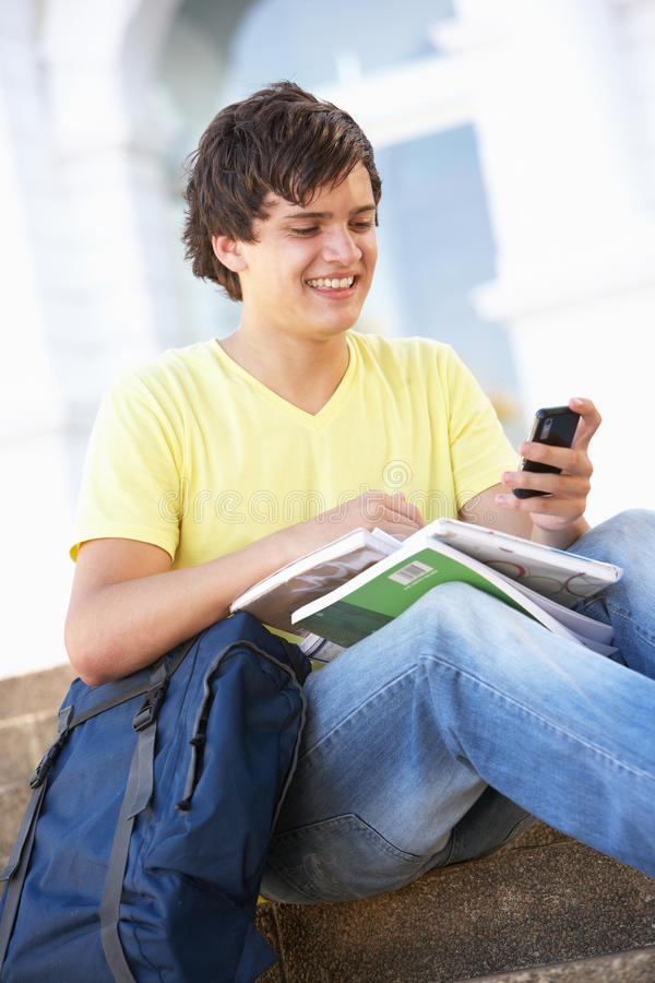 Download Male Teenage Student Sitting On College Steps Stock Photo - Image of carrying, files: 14633840