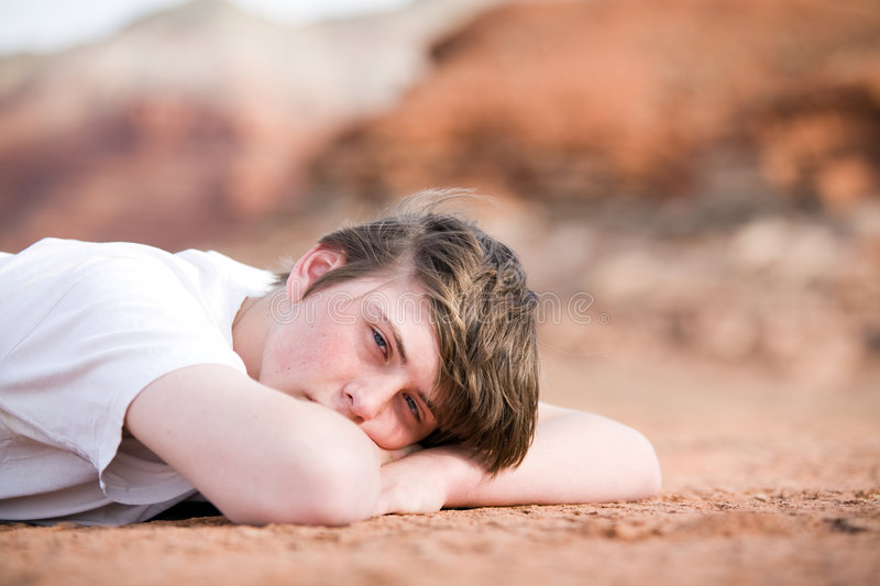 Download Male Teenager Laying On Ground Stock Photos - Image: 5126603