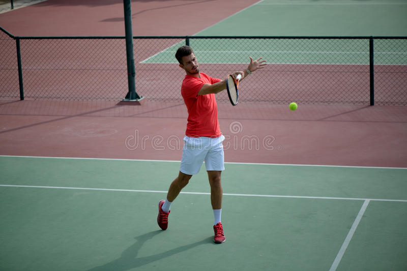 Male tennis player practice in tennis court royalty free stock photography