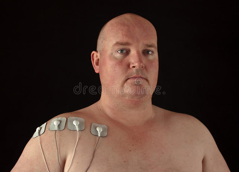 Male With Tens Senors On His Body For Massage Royalty Free Stock Photography