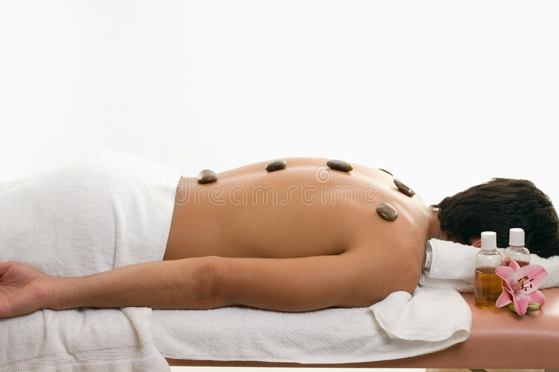 Male thermal stone spa treatment royalty free stock images