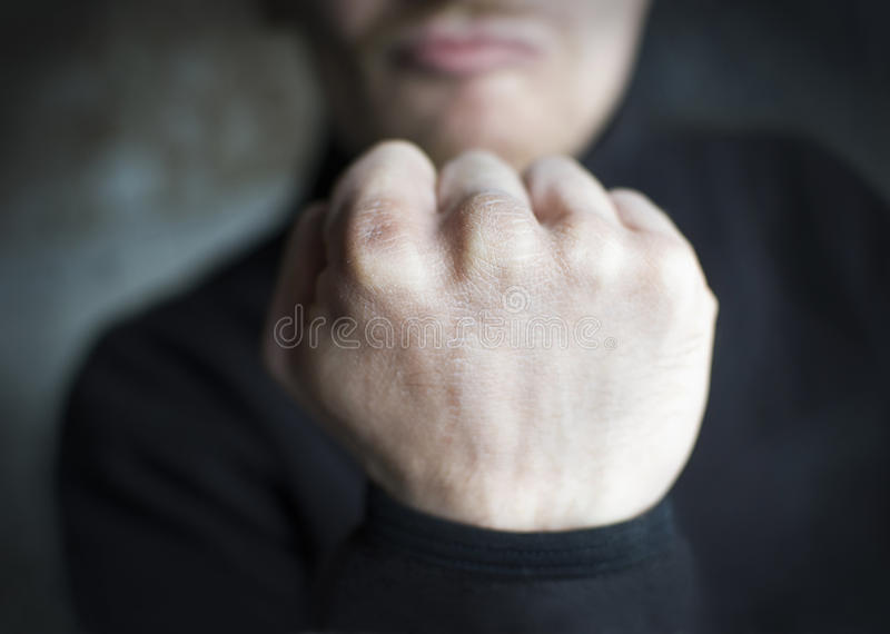 Male threatening gesture, fist stock photography