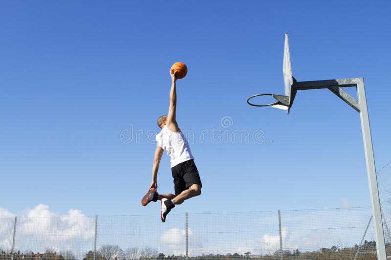Basketball Slam Dunk. Male about to slam dunk royalty free stock image