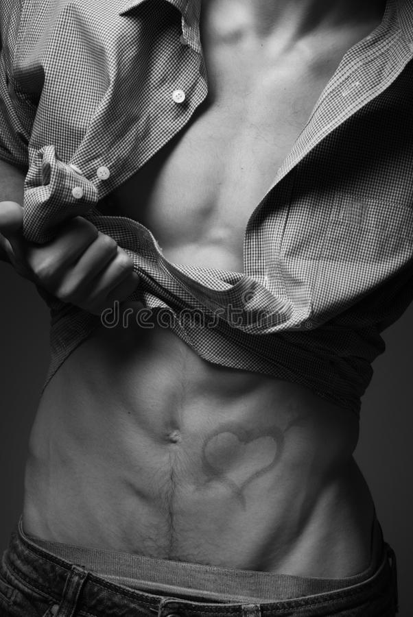 Male torso with a drawn heart stock image