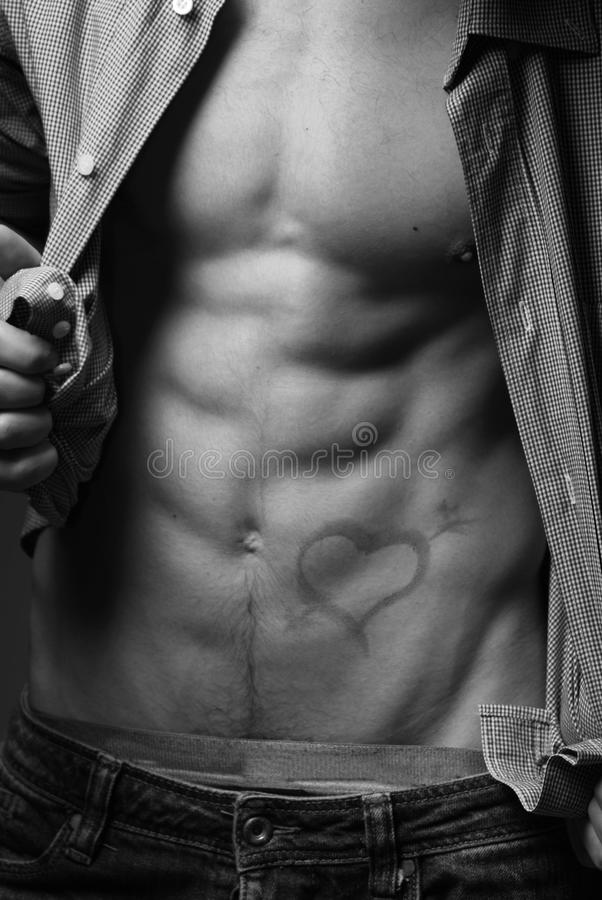 Male torso with a drawn heart stock photography