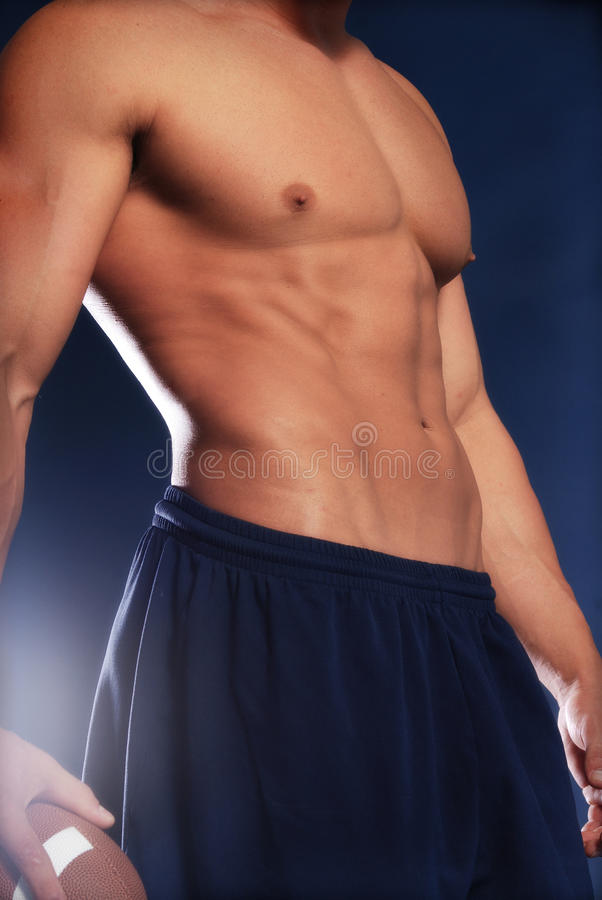 Male torso with football stock images