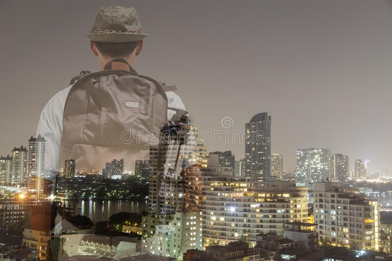 Male tourist with Back packer standing and looking city, double royalty free stock image