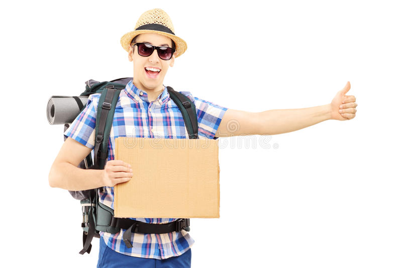 Male tourist with backpack hitchhiking. Isolated on white background stock photo
