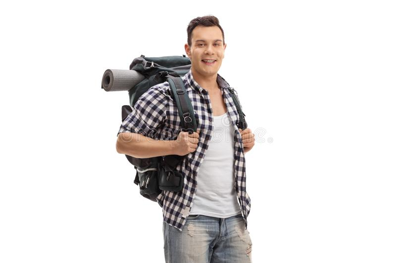 Male tourist with a backpack smiling at the camera stock photo