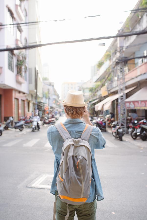 Male tourist backpackers travel summer traveler holidays in the city stock photos