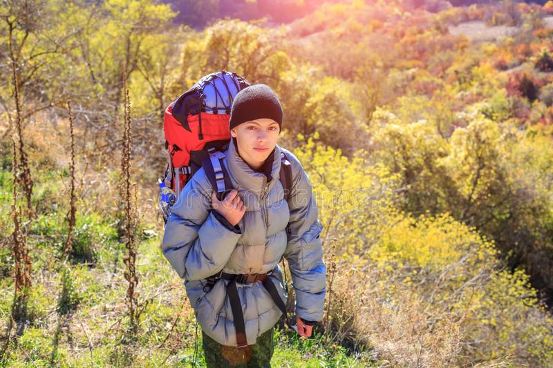 The male tourist comes with a backpack through the woods travel concept royalty free stock images