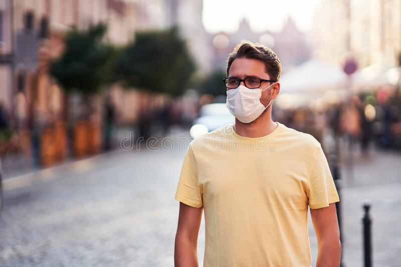 Male tourist in mask sightseeing Gdansk Poland royalty free stock image