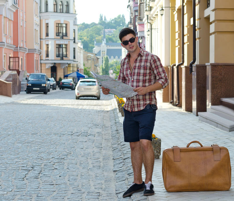 Download Male Tourist With A Suitcase And Map Stock Photo - Image: 25977018