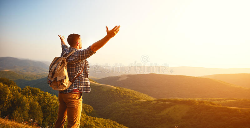 Male tourist on top of mountain in fog in autumn. Male tourist on top of gray mountain in fog in autumn stock images