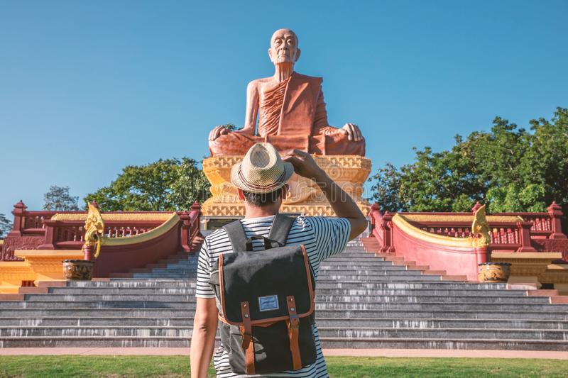 Male tourists are standing in front of a large public display in Surin, Thailand.  royalty free stock images