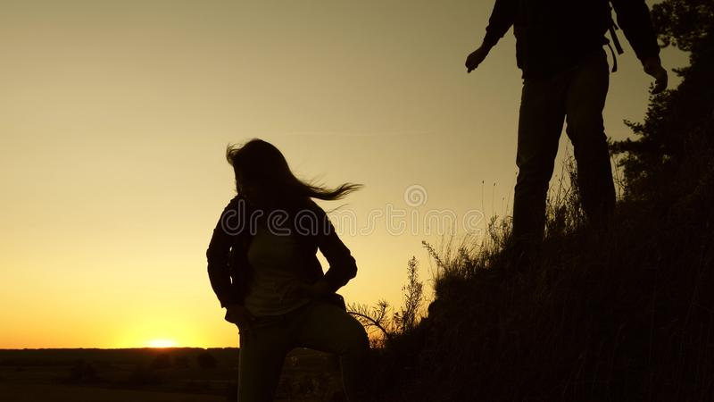 Male traveler and female traveler descend from the top of the hill. teamwork of business people. tourists descend from. Male traveler and female traveler descend royalty free stock photos