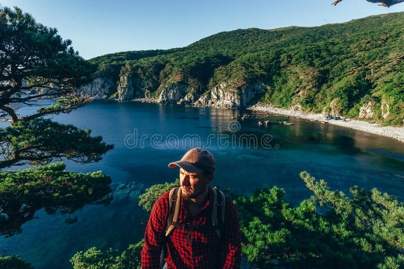 Male traveler on the sea coast royalty free stock images