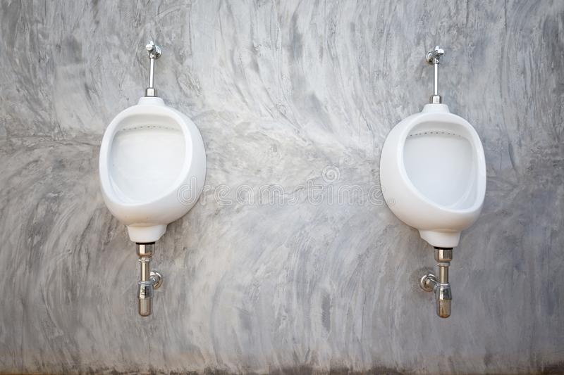 Male urinal white or sanitary ware in office modern loft. Style royalty free stock images