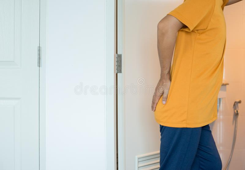 Male using toilet and suffers from Diarrhea and  Hemorrhoids after wake up in morning. Man using toilet and suffers from Diarrhea and  Hemorrhoids after wake up royalty free stock photos