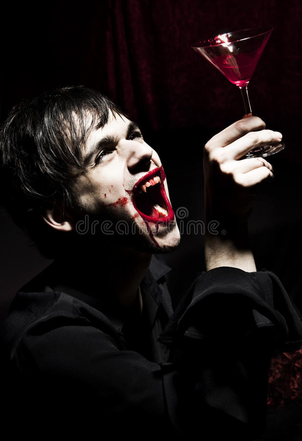 Download Male vampire and a glass stock image. Image of drink - 20611235