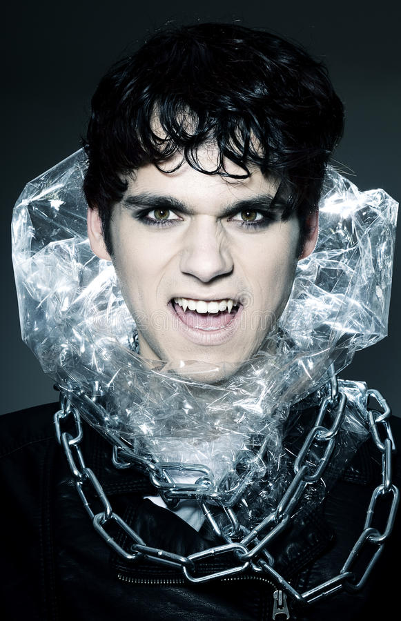Male vampire showing his fangs stock photography