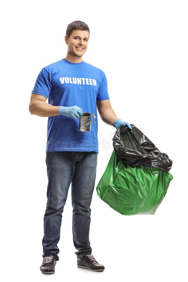 Male volunteer holding a bag and a tin can royalty free stock photography
