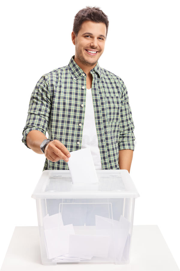 Male voter casting a vote into a ballot box. Isolated on white background royalty free stock photo